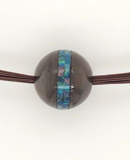 Green-Saturn-opal-bead-mosaic-boulder